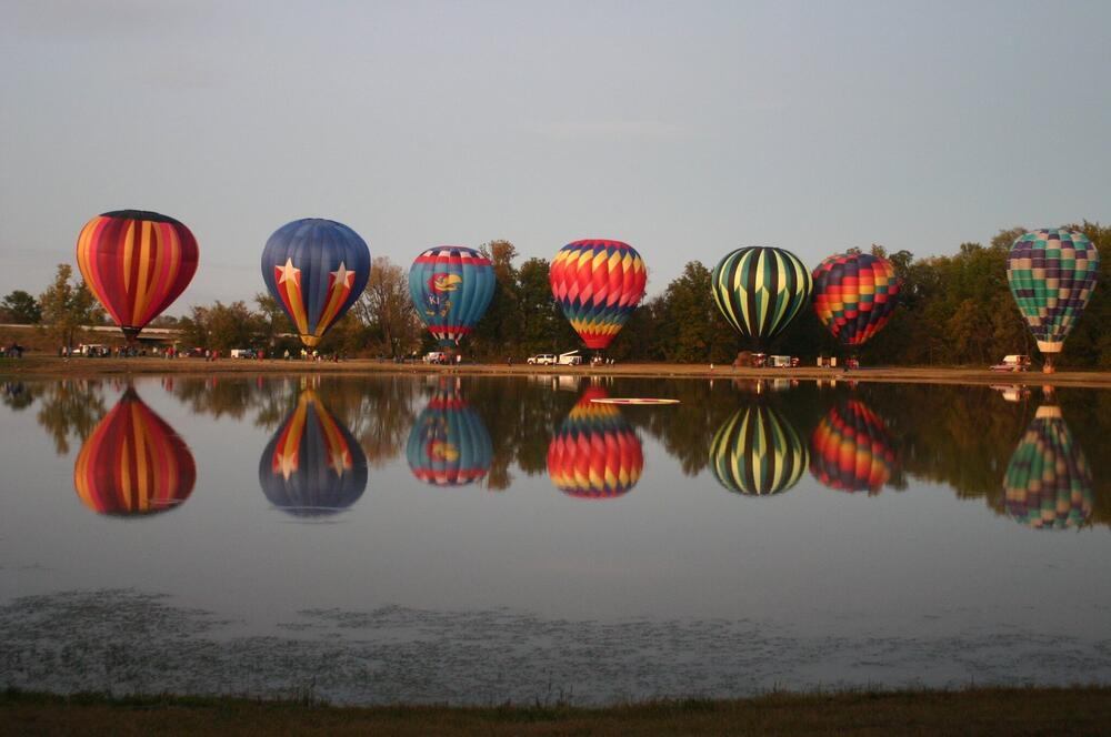 A line of 7 hot air balloons